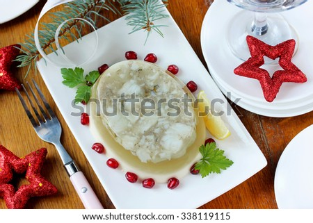Appetizer of jellied fish on a festive table, selective focus - stock photo