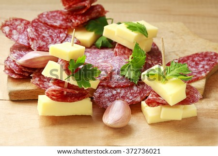 appetizer of sausage and cheese - stock photo