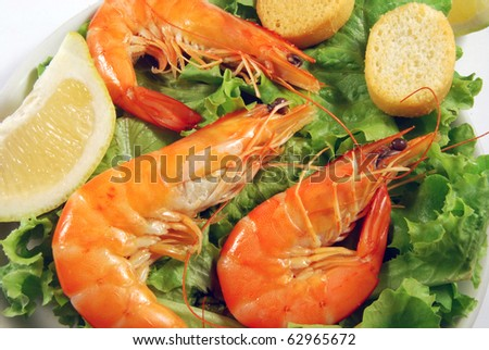 Appetizer of shrimp served on a bed of lettuce
