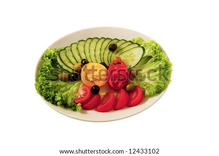 appetizer - paprika with tomato and cucumber on white plate