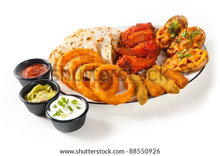Appetizer plate with dipping sauces on white - stock photo