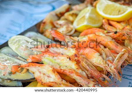 Appetizer plate with grilled shrimps and mussels - stock photo