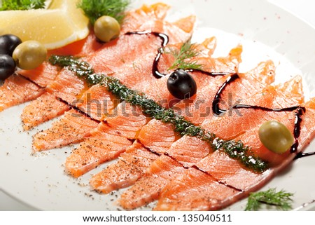Appetizer - Salmon Carpaccio with Balsamic Sauce, Olives and Lemon Slice