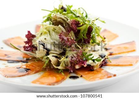 Appetizer - Salmon Carpaccio with Salad Mix - stock photo