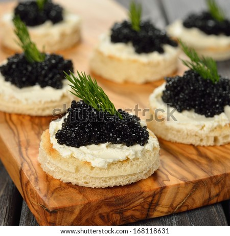 Appetizer with caviar close-up  - stock photo