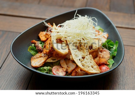 Appetizer with grilled chicken fillet, cheese and croutons  - stock photo