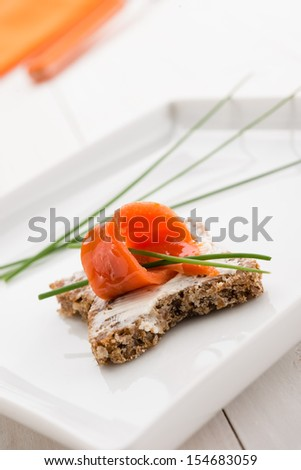 Appetizer with salmon canapes and cheese cream, closeup - stock photo