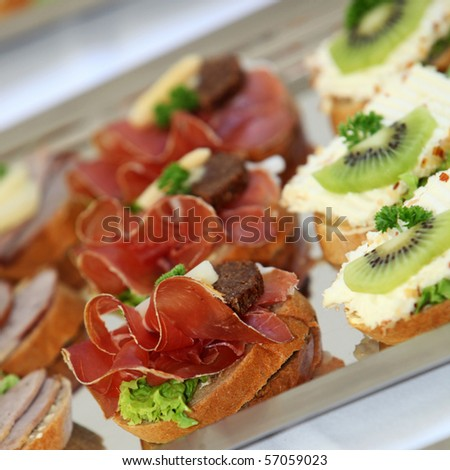 Appetizers and finger food - closeup - stock photo