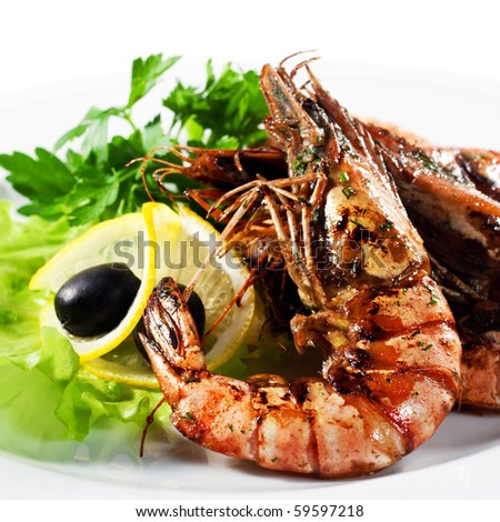 Appetizers - Grilled Shrimp with Parsley , Lemon Slice and Olive - stock photo