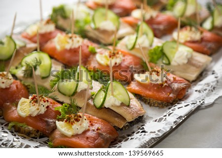 Appetizers on a tablet served by a caterer in a restaurant or hotel - stock photo