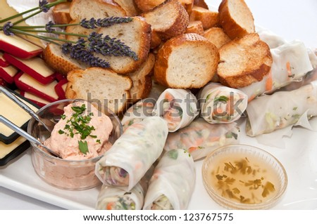 Appetizers selection with breads and cheeses on a  platter at an event - stock photo