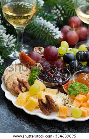 appetizers to the holiday - cheeses, fruits and jams, vertical, closeup, top view - stock photo