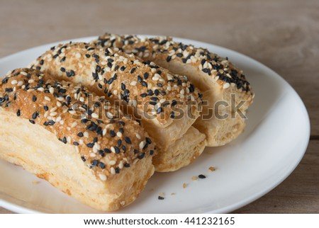 Appetizers with puff pastry with various fillings sprinkled with seeds
