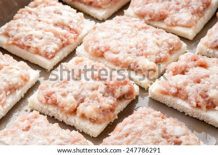appetizers with salami paste into the pan - stock photo
