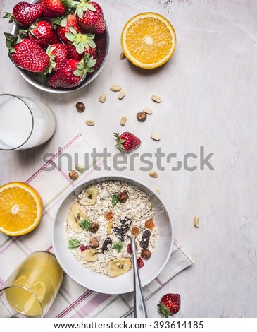 appetizing breakfast with fresh strawberries, oatmeal, orange juice border ,place for text on wooden rustic background top view close up - stock photo