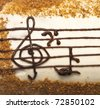 appetizing cake with treble clef drawing by cream - stock photo