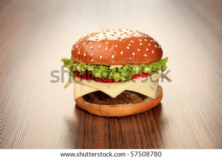 Appetizing cheeseburger. Isolated over white background. - stock photo