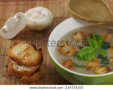 appetizing cream soup with champignon mushrooms  - stock photo