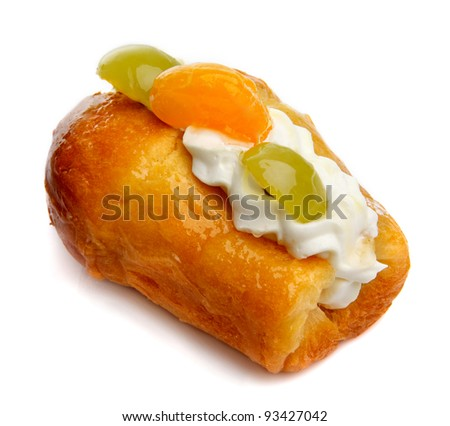 Appetizing eclairs with fruits on white background
