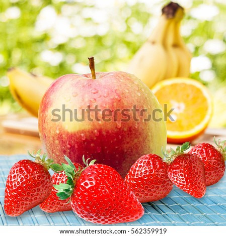 Appetizing fresh fruit.Ripe red strawberry,apple,orange,yellow bananas