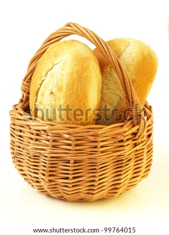 Appetizing fresh rolls in wicker basket, isolated - stock photo