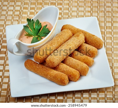 Appetizing fried chicken nuggets with sauce - stock photo