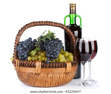 Appetizing grapes in a basket and bottle of wine on a white background.