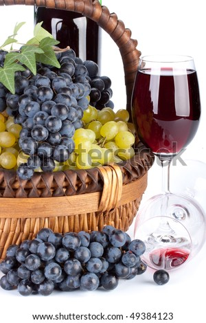 Appetizing grapes in a basket and bottle of wine on a white background. - stock photo