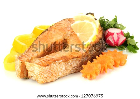 Appetizing grilled salmon with lemon and vegetables isolated on white
