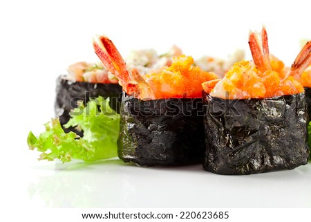 Appetizing Japanese sushi isolated on white reflexive background - stock photo