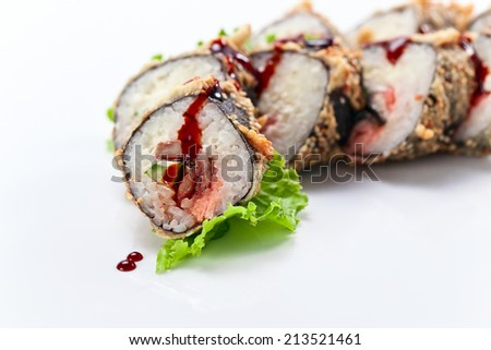 Appetizing Japanese sushi with salad leaves - stock photo