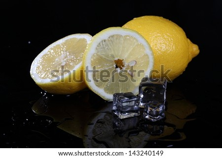 Appetizing juicy fragrant beautiful lemon with cubes of cold ice - stock photo