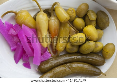 Appetizing marinated vegetables on a white plate
