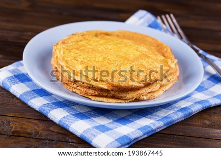 Appetizing pancakes on plate on table. Healthy breakfast. Selective focus, horizontal.