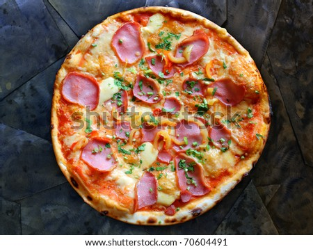 Appetizing pizza with bacon and pepper on stone - stock photo