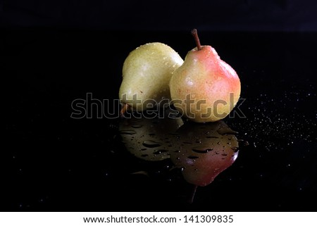 Appetizing ripe juicy beautiful pure in drops of water of a pear - stock photo