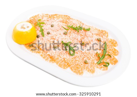 Appetizing salmon carpaccio with arugula and italian parmesan. Isolated on a white background. - stock photo