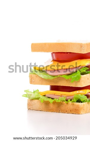 Appetizing sandwich with ham and cheese. Isolated on a white background.