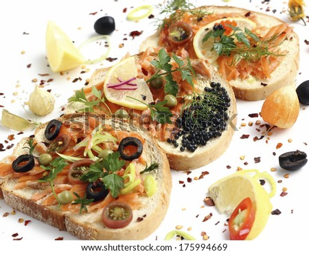 Appetizing sandwiches with smoked salmon and vegetables - stock photo