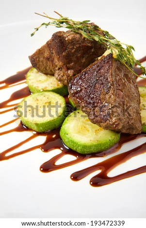 Appetizing steak with vegetables isolated on white background