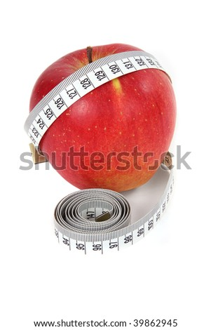 Apple and a measure tape, diet concept - stock photo