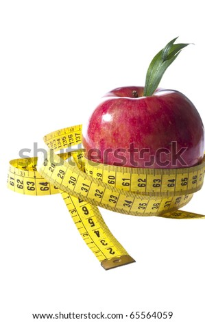 Apple and a measure tape - diet concept - - stock photo