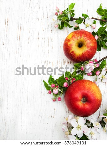 apple and apple tree blossoms on a wooden background - stock photo