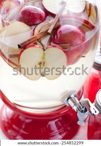 Apple and cinnamon lemonade, drink in a glass beverage, water dispenser - stock photo