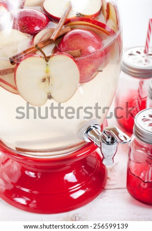 Apple and cinnamon lemonade, drink in a glass beverage, water dispenser - stock photo