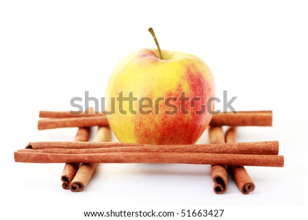 apple and cinnamon sticks on white - fruits and vegetables