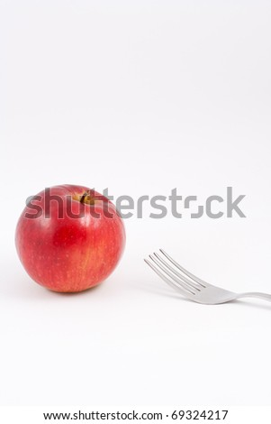 apple and fork - stock photo