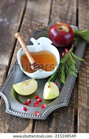 Apple and honey, traditional food of Jewish New Year - stock photo