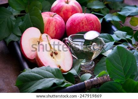 Apple and honey, traditional food of jewish New Year celebration, Rosh Hashana. - stock photo