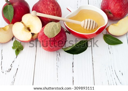 Apple and honey, traditional food of jewish New Year - Rosh Hashana. Copyspace background - stock photo